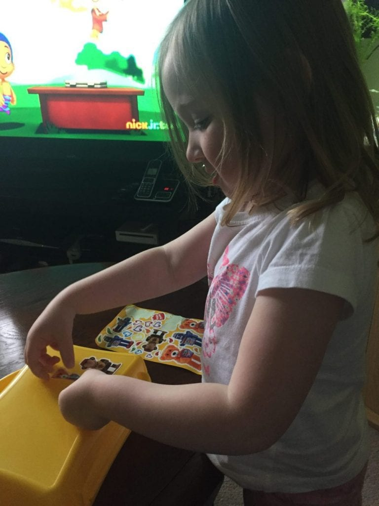 Mia decorating her lunchbox