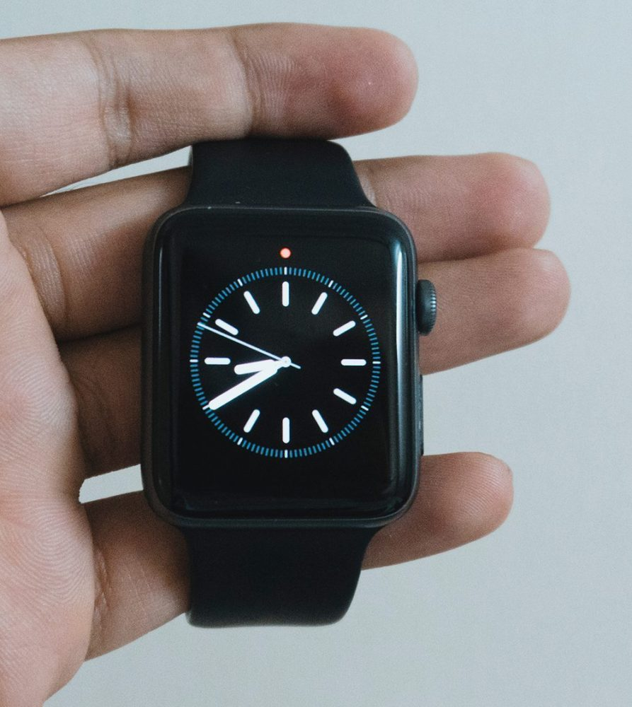 Tech Gifts - Black smart watch with analogue clock display