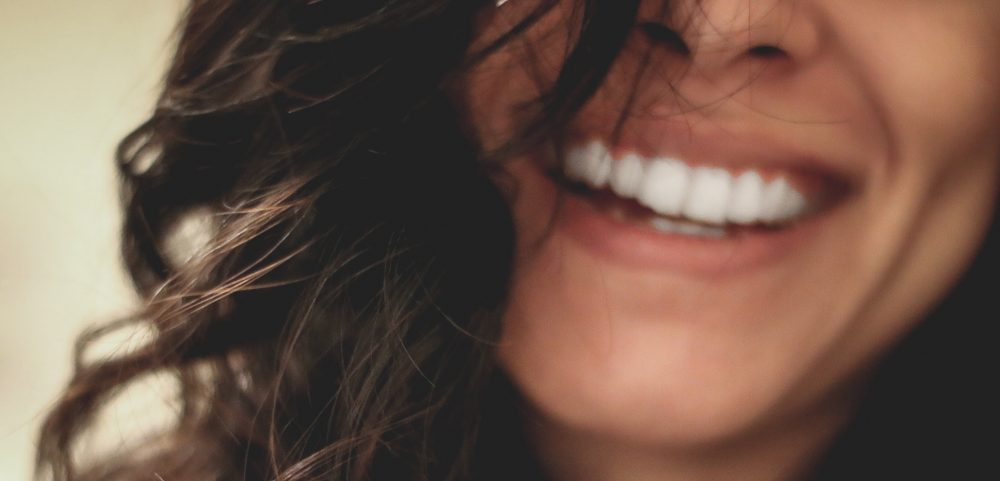 Brunette Lady With Large Toothy Smile