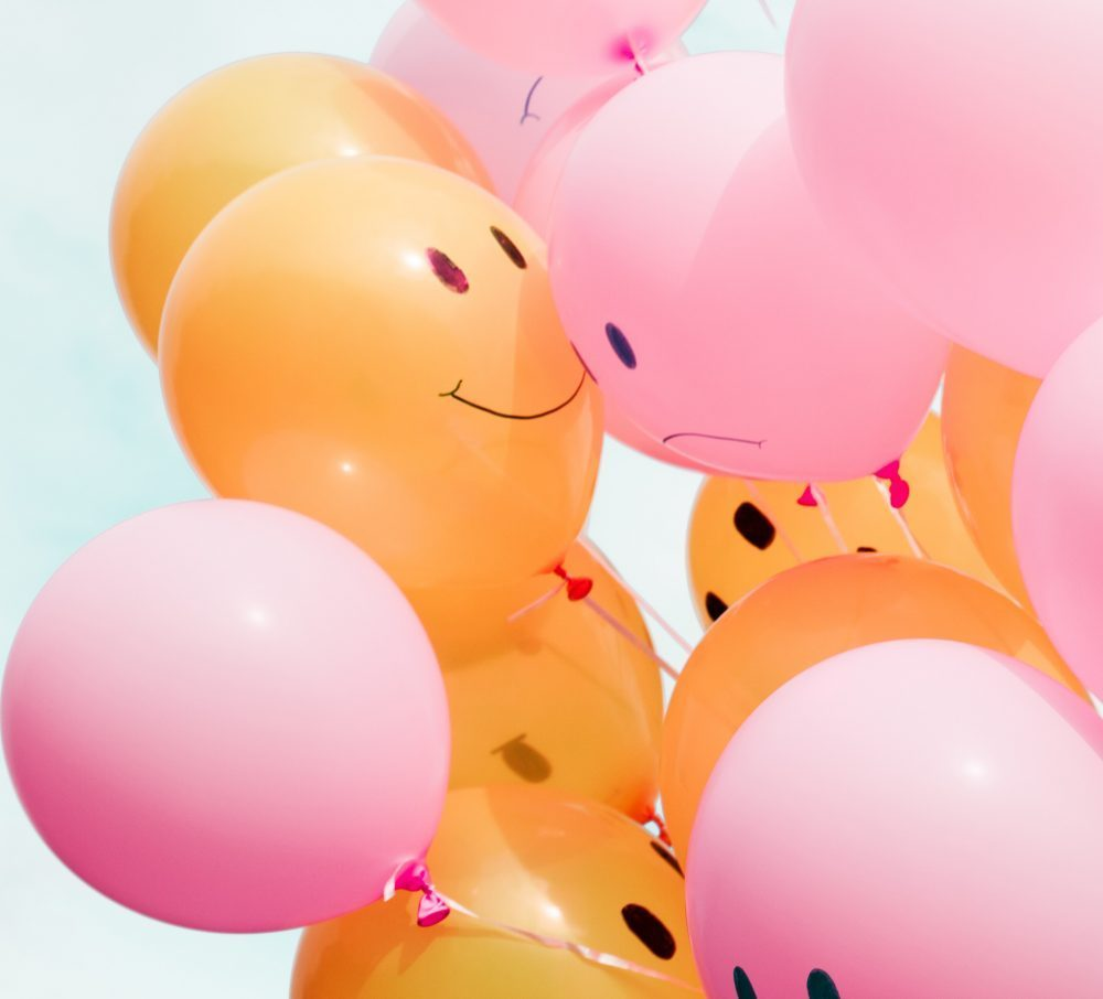 Pink and Orange Balloons with Smiley and Sad Faces