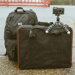Packed bags and a camera on a tripod
