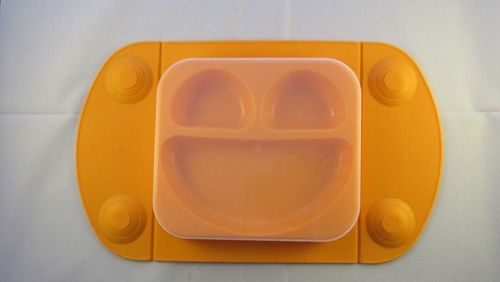 Orange suction mat against white background