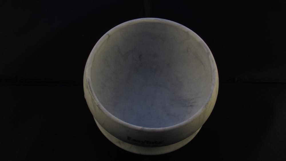 Grey marble effect bowl against black background