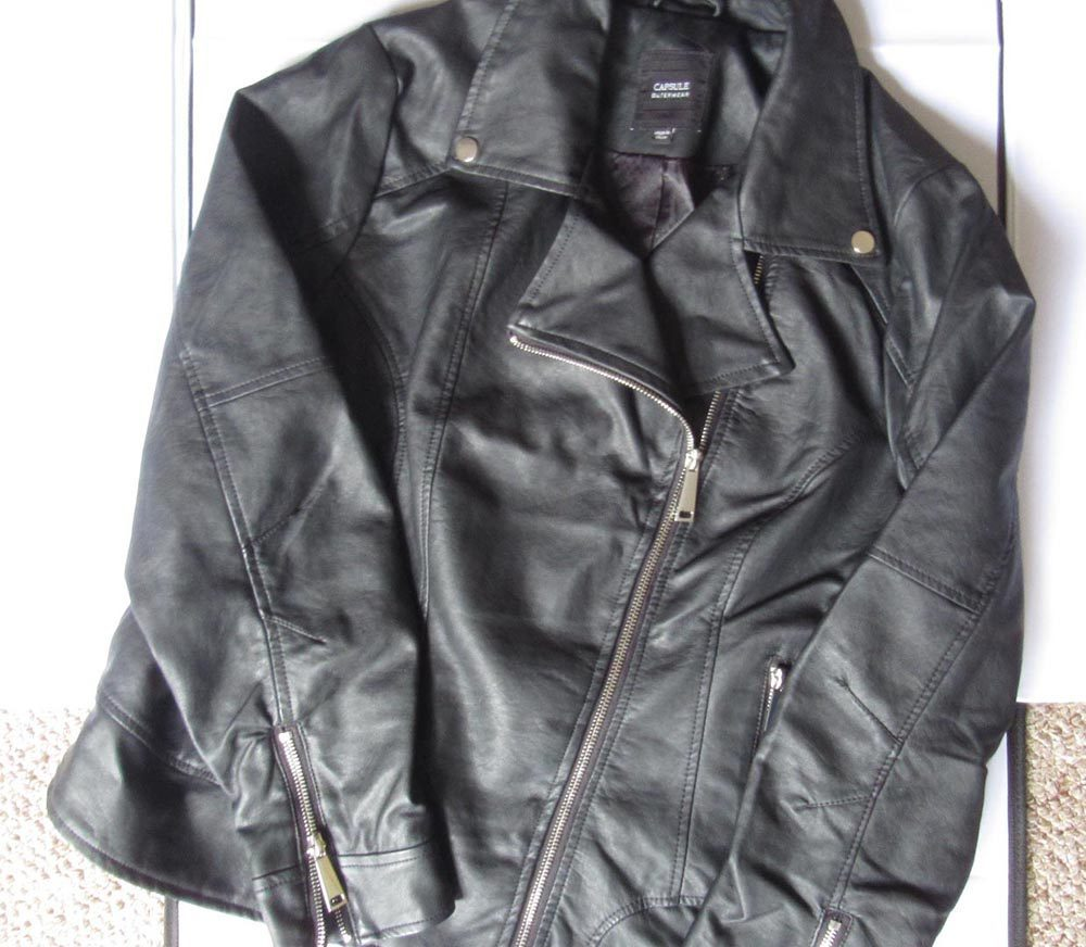 Black biker jacket with asymmetrical zip