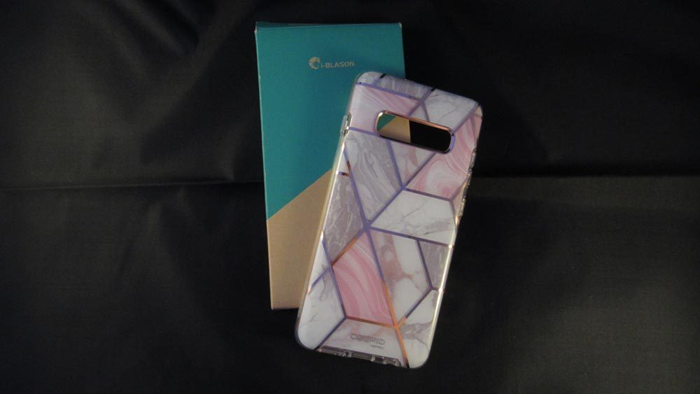 marble effect phone case resting on box against a black background