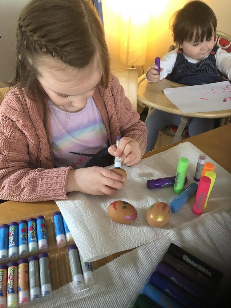 Painting Hard Boiled Eggs with green paint sticks