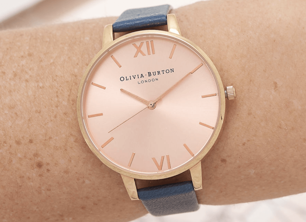 Rose gold olivia burton watch with navy blue stap