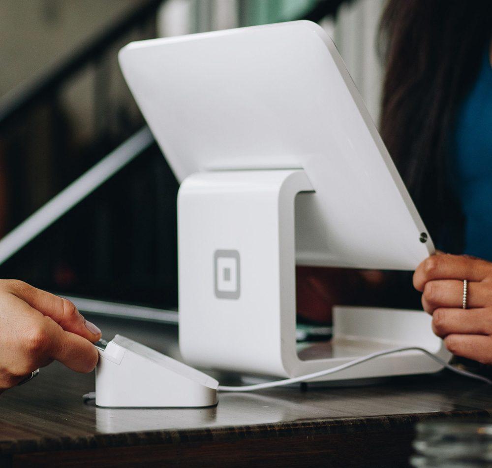 White digital till with digital car reader