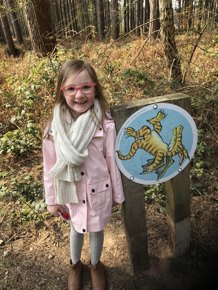 Mia with a dragon trail sign
