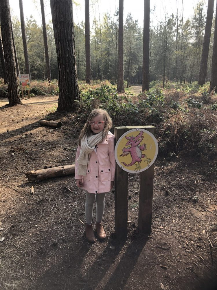 Mia stood with a dragon trail sign