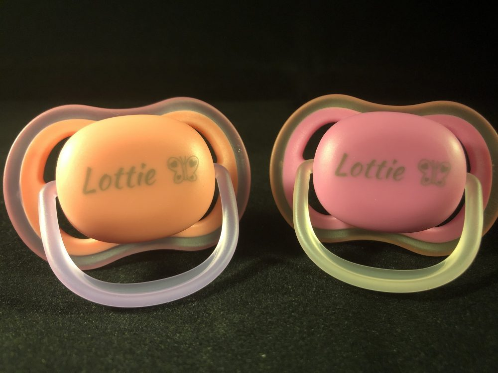 Personalised orange and pink dummies