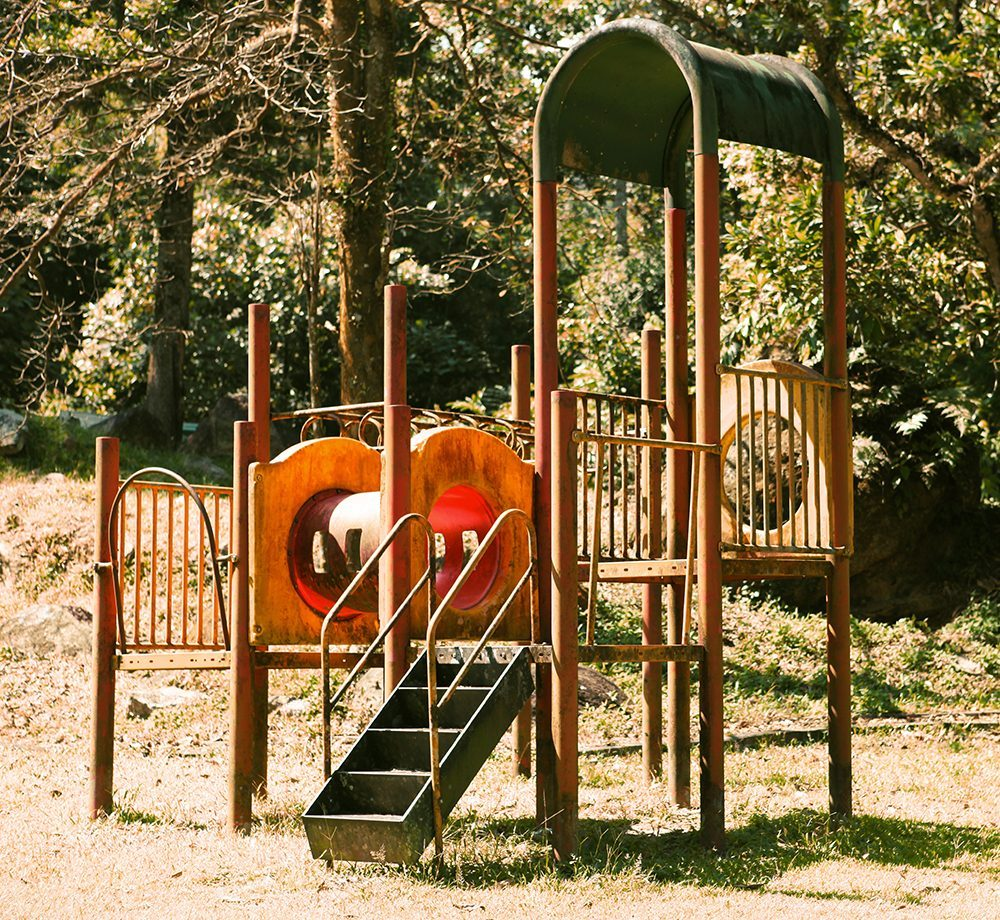 Playground play frame in a grassier area